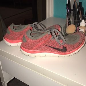 Nike fly knit running shoes.